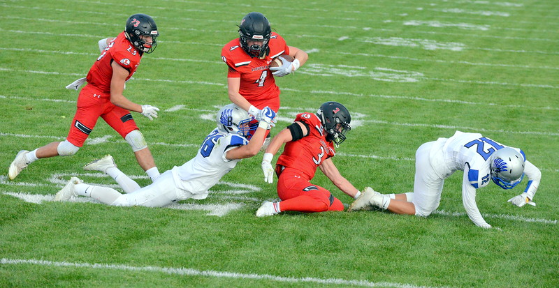 Loveland's Cody Rakowsky gets brought down by Broomfield's Lorenzo Rodriquez during Thursday's game at Patterson Field. (Mike Brohard/Loveland Reporter-Herald)