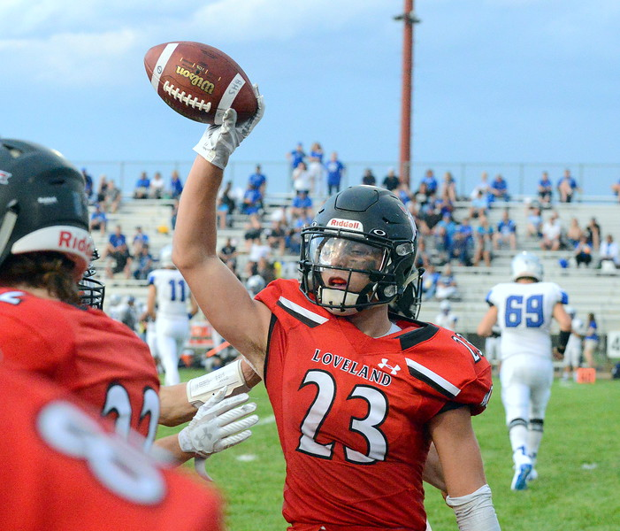 Loveland's Caleb Smith celebrates his second-quarter interception in Thursday's game with Broomfield at Patterson Stadium. (Mike Brohard/Loveland Reporter-Herald)