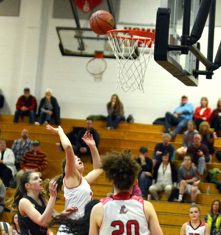 . Loveland\'s Kajsa Borrman goes up for a shot during Tuesday\'s game with Fort Collins at LHS. (Mike Brohard/Loveland Reporter-Herald)