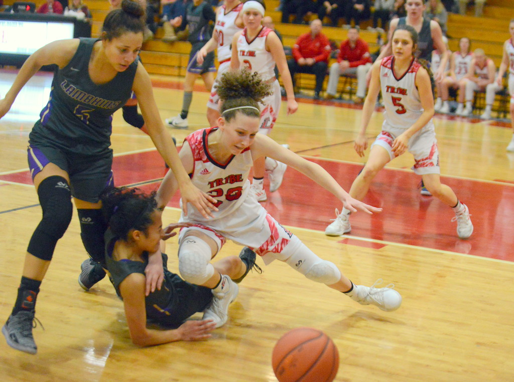 . Loveland\'s livia McQuade battles a pair of Fort Collins defenders for a loose ball during Tuesday\'s game at LHS. (Mike Brohard/Loveland Reporter-Herald)