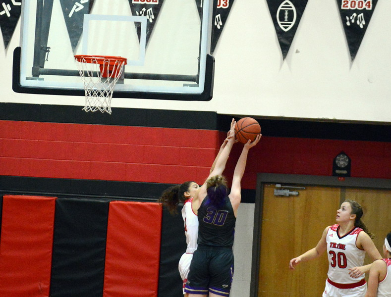 Loveland's Kennedy Burch defends the shot of Fort Collins' Laura Davis during Tuesday's game at the LHS gym. (Mike Brohard/Loveland Reporter-Herald)