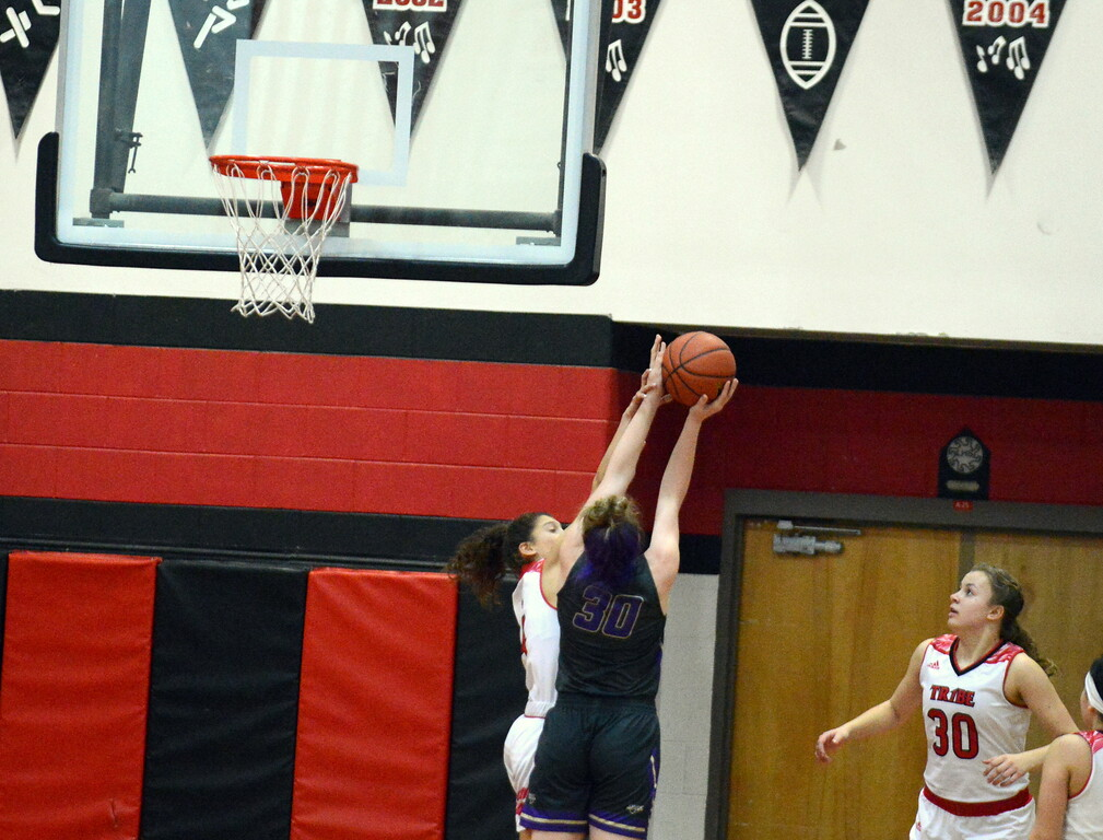 . Loveland\'s Kennedy Burch defends the shot of Fort Collins\' Laura Davis during Tuesday\'s game at the LHS gym. (Mike Brohard/Loveland Reporter-Herald)