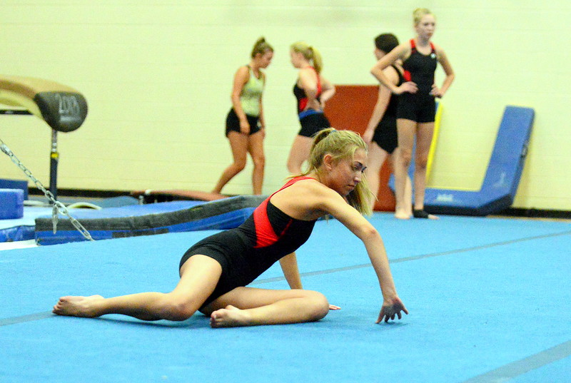 Hannah White works on her floor routine during a recent practice in the Glover Gym at LHS. (Mike Brohard/Loveland Reporter-Herald)