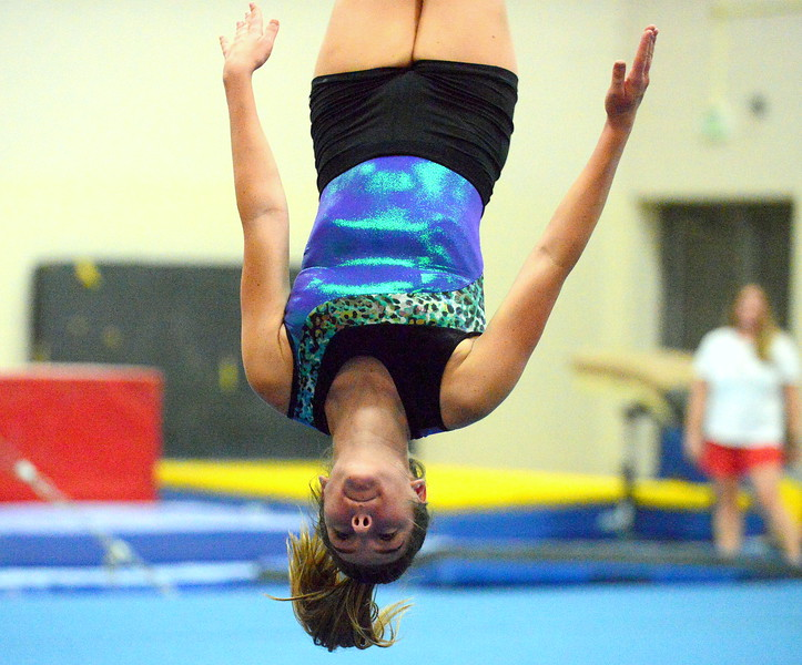 Natalie Lichter finds the floor as she works on her tumbling pass for her floor routine in practice. Loveland, sixth at state in 4A in 2017, is looking for a repeat trip to state as a team. (Mike Brohard/Loveland Reporter-Herald)