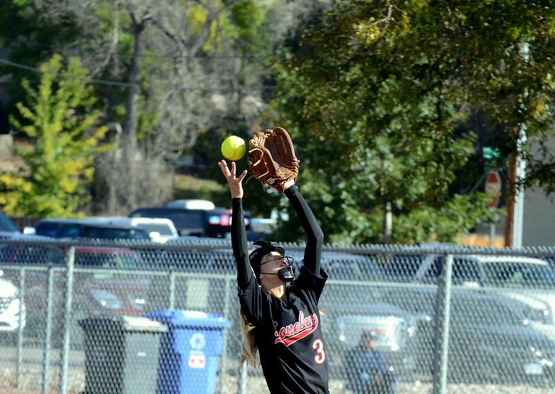 Loveland second baseman Avery Buhler has a pop up just elude her during Saturday's game with Pine Creek at the 5A Region 4 tournament at the Barnes Complex in Loveland. The Indians won 9-2. (Mike Brohard/Loveland Reporter-Herald)