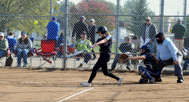 Loveland's SAllison Westbrook connects for a solo home run  during Saturday's game with Pine Creek at the 5A Region 4 tournament at the Barnes Complex in Loveland. The Indians won 9-2. (Mike Brohard/Loveland Reporter-Herald)