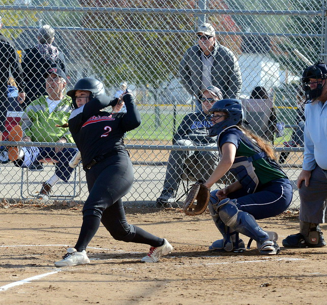 Loveland's Elana Gerhard follows through on her swing after delivering an RBI single  during Saturday's game with Pine Creek at the 5A Region 4 tournament at the Barnes Complex in Loveland. The Indians won 9-2. (Mike Brohard/Loveland Reporter-Herald)
