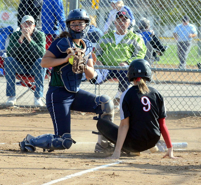 Loveland's Alex Villafranco slides safely into home as Pine Creek catcher Avery Tyler gets the ball late  during Saturday's game at the 5A Region 4 tournament at the Barnes Complex in Loveland. The Indians won 9-2. (Mike Brohard/Loveland Reporter-Herald)