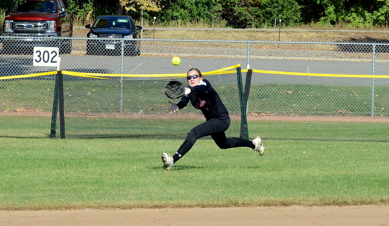 Loveland center fielder Katie McClain comes in to make a sliding catch on a sinking liner  during Saturday's game with Pine Creek at the 5A Region 4 tournament at the Barnes Complex in Loveland. The Indians won 9-2. (Mike Brohard/Loveland Reporter-Herald)