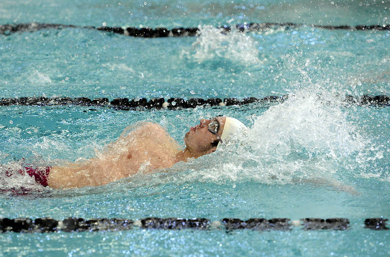 Ben Smith of Thompson Valley reaches back during the backstroke leg of the 200 individual medley during Saturday's Northern Conference championships. Smith took second in the race.  (Photo by Mike Brohard/Loveland Reporter-Herald)