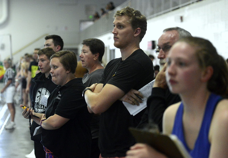 The coaching staffs of Mountain View and Thompson Valley watch the finals of the 200-yard freestyle relay closely during Saturday's Northern Conference championships. The Eagles won the event, while the Lions took fifth.  (Photo by Mike Brohard/Loveland Reporter-Herald)