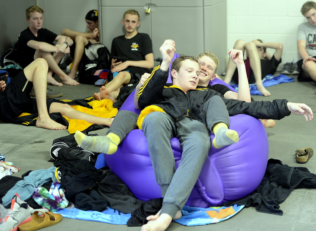 . Thompson Valley teammates Garrett Britt, front, and Chris Eddy share an inflateable couch during the Northern Conference championships on Saturday. The two combined to help all three relays take first and won three individual titles between them. (Photo by Mike Brohard/Loveland Reporter-Herald)