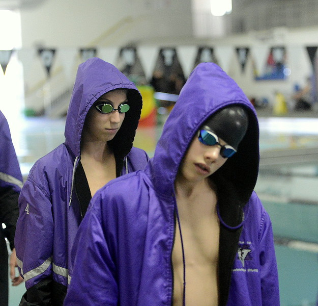 Mountain View's Max Bridges, back, and Matyi Mayo march out before the start of the 200-yard medley relay at Saturday's Northern Conference championships. The Lions placed fifth in the event.  (Photo by Mike Brohard/Loveland Reporter-Herald)