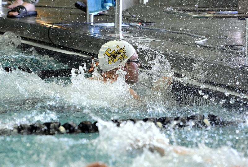 Water sprays all around as Thompson Valley's Jack Kisch touches the wall first at the end of the 50-yard freestyle at Saturday's Northern Conference championships. Kisch won the event, one of eight race titles on the day for the team.  (Photo by Mike Brohard/Loveland Reporter-Herald)