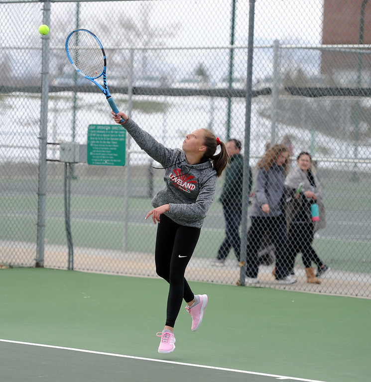 . Aubrey Woodard connects on a serve during the No. 3 singles match at Loveland High School on Friday, April 12. Loveland lost to Fossil Ridge 5-2. (Colin Barnard/Loveland Reporter-Herald)