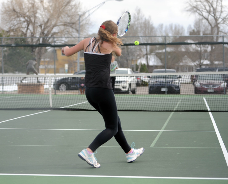 Rebecca Emme returns a serve during her No. 2 singles match at Loveland High School on Friday, April 12. Loveland lost to Fossil Ridge 5-2. (Colin Barnard/Loveland Reporter-Herald)