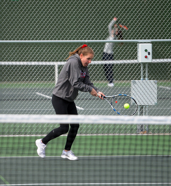 Emmy Barbattini connects on a backhand during her No. 2 doubles match at Loveland High School on Friday, April 12. Loveland lost to Fossil Ridge 5-2. (Colin Barnard/Loveland Reporter-Herald)