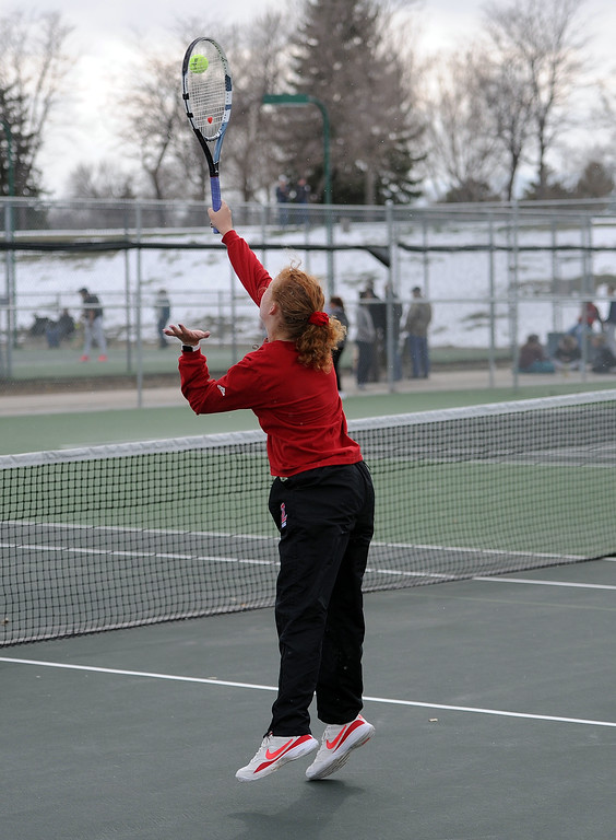 . Kindsey Knapp jumps for a volley during her No. 3 doubles match at Loveland High School on Friday, April 12. Loveland lost to Fossil Ridge 5-2. (Colin Barnard/Loveland Reporter-Herald)