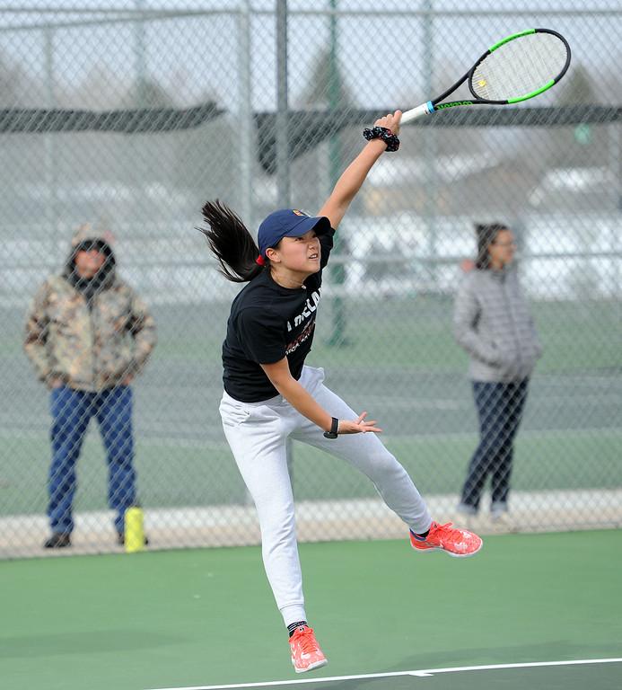 . Beilynn Geiss unleashes a serve in the No. 1 singles match at Loveland High School on Friday, April 12, 2019. Loveland lost 5-2 to Fossil Ridge. (Colin Barnard/Loveland Reporter-Herald)