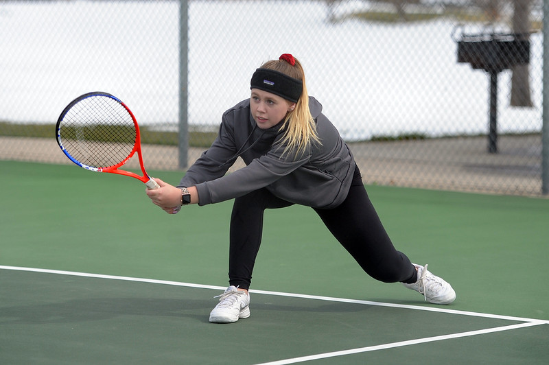 Jenna Dove leans into a backhand during her No. 4 doubles match at Loveland High School on Friday, April 12. Loveland lost to Fossil Ridge 5-2. (Colin Barnard/Loveland Reporter-Herald)