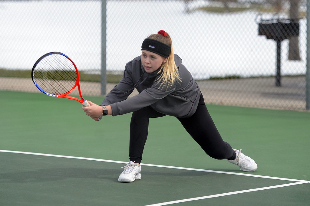 . Jenna Dove leans into a backhand during her No. 4 doubles match at Loveland High School on Friday, April 12. Loveland lost to Fossil Ridge 5-2. (Colin Barnard/Loveland Reporter-Herald)