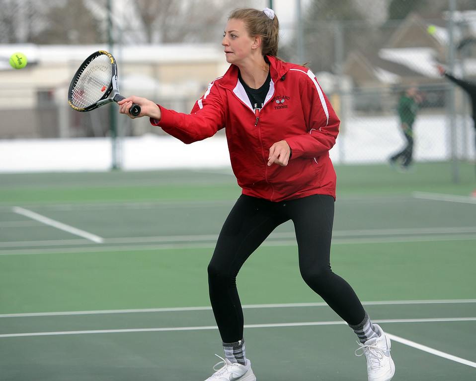 . Katie Kaufman hits a volley during the No. 4 doubles match at Loveland High School on Friday, April 12. Loveland lost to Fossil Ridge 5-2. (Colin Barnard/Loveland Reporter-Herald)