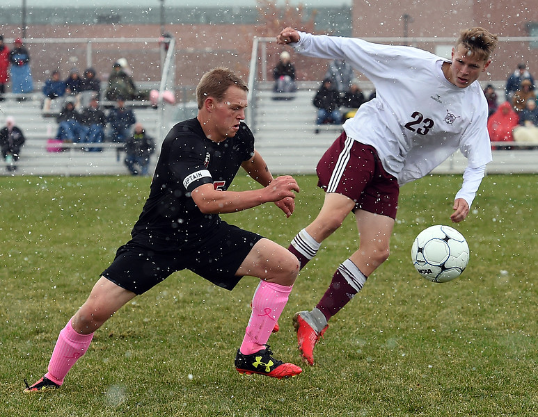 Loveland's (15) Cabel Vanderwarf and Berthoud's (23) Conrad Ellis go for the ball during their game Wednesday, Oct. 10, 2018, at Mountain View High School in Loveland.  (Photo by Jenny Sparks/Loveland Reporter-Herald)