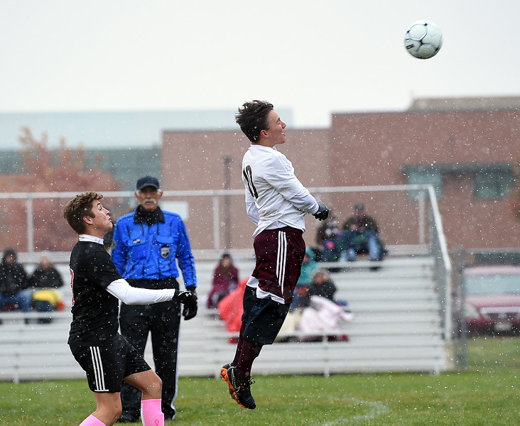 Berthoud's (10) Caden Grimditch goes up for a header during their game against Loveland Wednesday, Oct. 10, 2018, at Mountain View High School in Loveland.  (Photo by Jenny Sparks/Loveland Reporter-Herald)