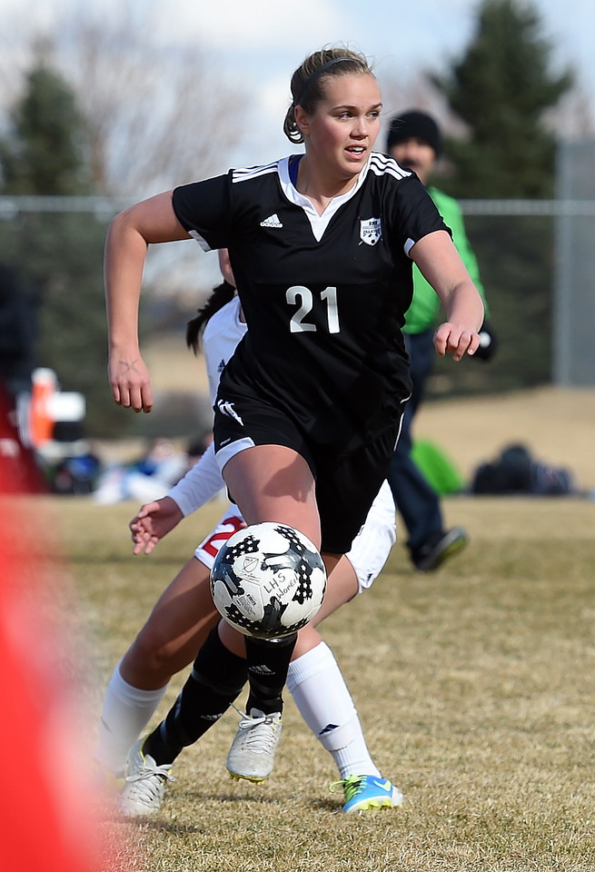 Berthoud's (21) Liz Bosnich takes the ball down field during their game against Loveland Monday, March 19, 2018, at Mountain View High School in Loveland. (Photo by Jenny Sparks/Loveland Reporter-Herald)