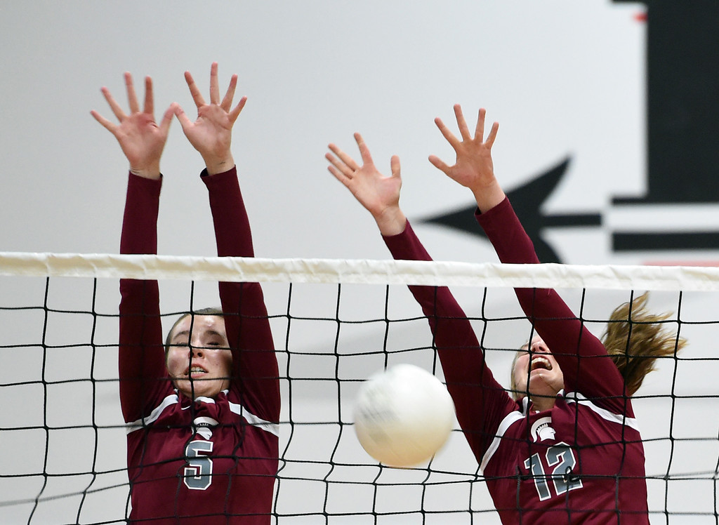 . Berthoud\'s Taylor Whittet and Teagan Holmes try to block the ball during their volleyball game against Loveland on Wednesday, Sept. 5, 2018, at Loveland High. (Photo by Jenny Sparks/Loveland Reporter-Herald)