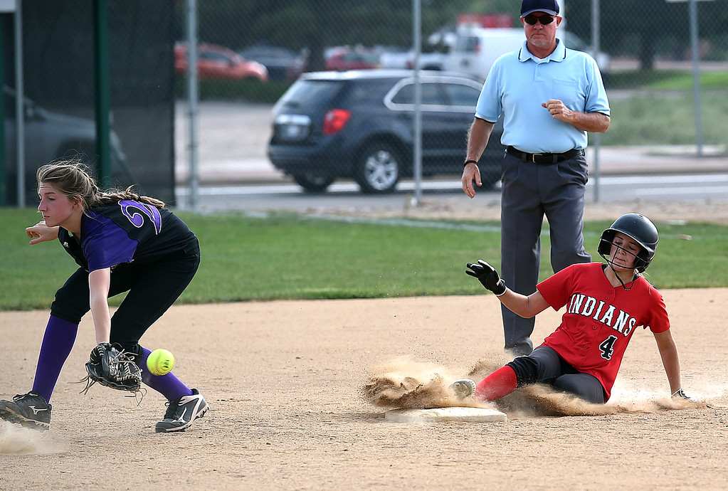 . Loveland High\'s (4) Katie McClain slides safely into second as Boulder High\'s (20) Anika Knowles tries to catch the ball Tuesday, Aug. 29, 2017, during their game at Centennial Park in Loveland. (Photo by Jenny Sparks/Loveland Reporter-Herald)