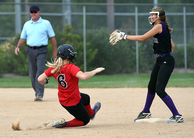 Loveland High's (6) Darrian Morby slides into second as Boulder High's (8) Maya  Hamilton tries to catch the ball Tuesday, Aug. 29, 2017, during their game at Centennial Park in Loveland. (Photo by Jenny Sparks/Loveland Reporter-Herald)<br /> L6 B8