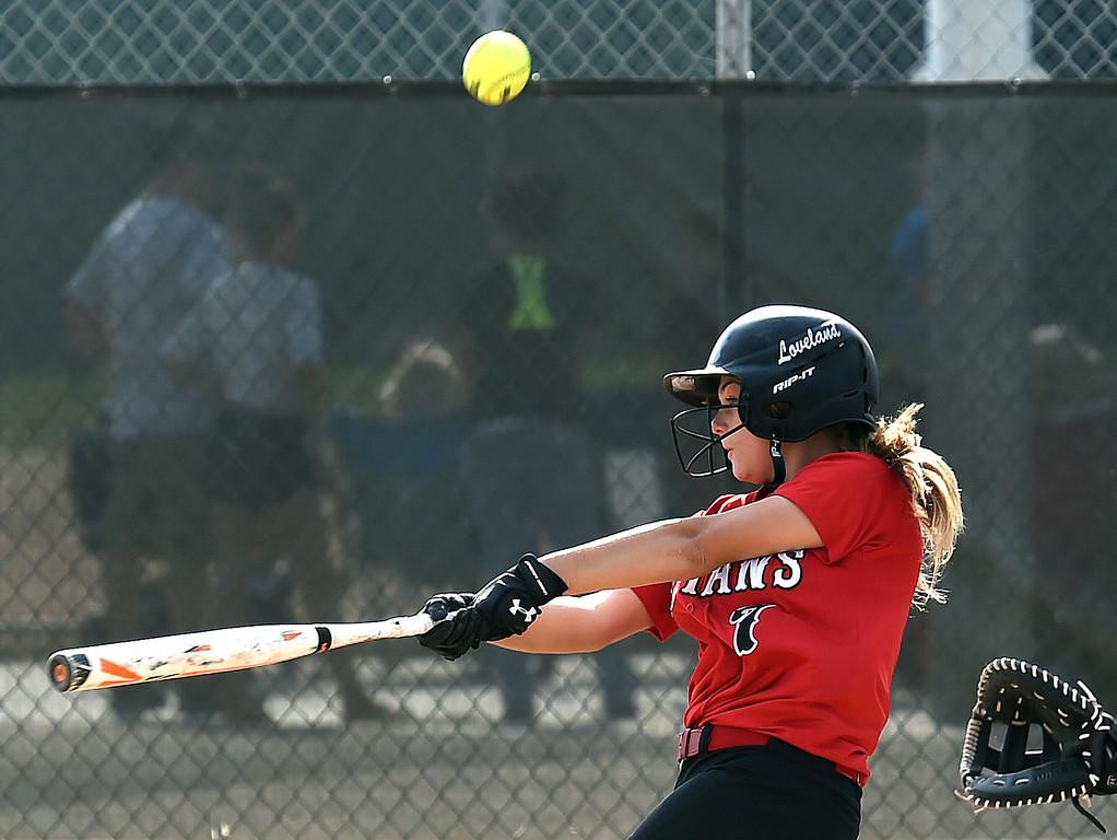 . Loveland High\'s (7) Emily Eggerling hits the ball Tuesday, Aug. 29, 2017, during their game against Boulder High at Centennial Park in Loveland. (Photo by Jenny Sparks/Loveland Reporter-Herald)