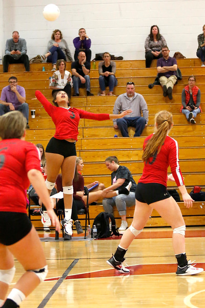 Loveland's Lacy Hunt (3) reaches back to hit the ball to Boulder at Loveland High School on Tuesday, Oct. 17, 2017. (Photo by Lauren Cordova/Loveland Reporter-Herald)