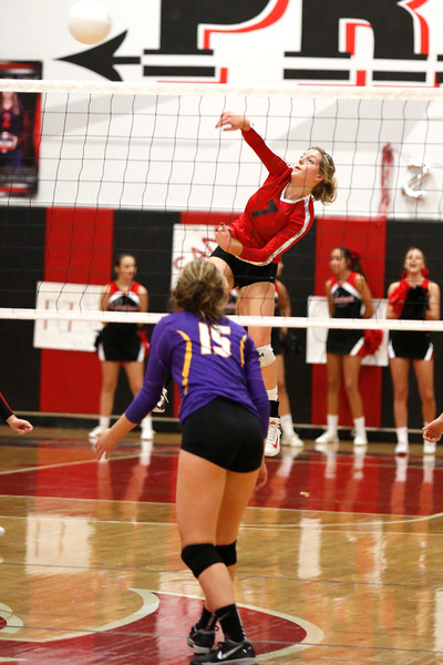 Loveland's Ava Jacobson (7) hits the ball back to Boulder as Fiona Quinn (15) waits to defend at Loveland High School on Tuesday, Oct. 17, 2017. (Photo by Lauren Cordova/Loveland Reporter-Herald)