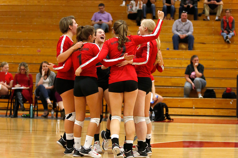 Loveland's Camryn Kelley (11) and her teammates celebrate scoring a point against Boulder in the second game of the set at Loveland High School on Tuesday, Oct. 17, 2017. (Photo by Lauren Cordova/Loveland Reporter-Herald)