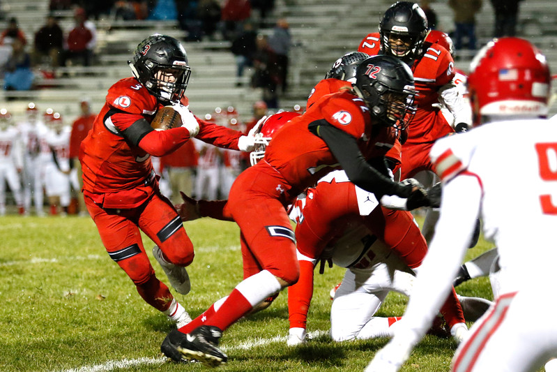 Loveland's Zachary Weinmaster (3) pushes back Brighton's Nicholas Martinez (56) and continues to run the ball with defensive help from Frank MacAlister (72), Caleb Smith (23) and Austin Jenkins (12) on Thursday, Oct. 26, 2017, at Patterson Stadium in Loveland. (Lauren Cordova/Loveland Reporter-Herald)