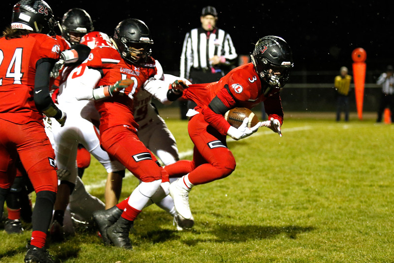 Loveland's Zachary Weinmaster (3) scores a touchdown with defensive help from Austin Jenkins (12) as Brighton's Nathan Baca (35) pulls on him on Thursday, Oct. 26, 2017, at Patterson Stadium in Loveland. (Lauren Cordova/Loveland Reporter-Herald)