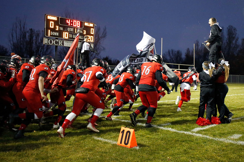 Loveland's varsity team storms the field before their game against Brighton as their cheerleaders cheer for them on Thursday, Oct. 26, 2017, at Patterson Stadium in Loveland. (Lauren Cordova/Loveland Reporter-Herald)