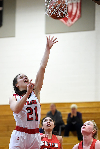 Loveland's Claira Gilchrist goes up for a shot during their game against Brighton Tuesday, Feb. 19, 2019, at Loveland High School.  (Photo by Jenny Sparks/Loveland Reporter-Herald)