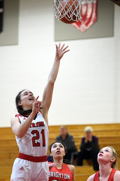 . Loveland\'s Claira Gilchrist goes up for a shot during their game against Brighton Tuesday, Feb. 19, 2019, at Loveland High School.  (Photo by Jenny Sparks/Loveland Reporter-Herald)