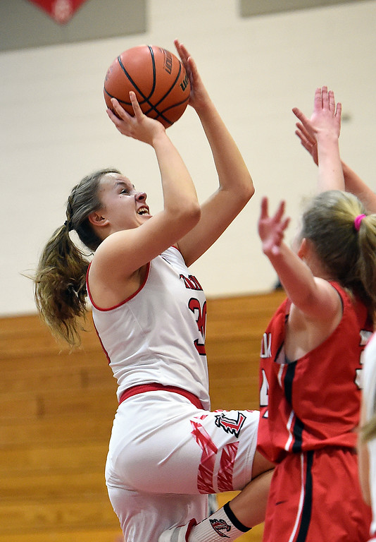 . Loveland\'s Kajsa Borrman goes up for a shot as Brighton\'s Brooke Johnson tries to block during their game Tuesday, Feb. 19, 2019, at Loveland High School.  (Photo by Jenny Sparks/Loveland Reporter-Herald)