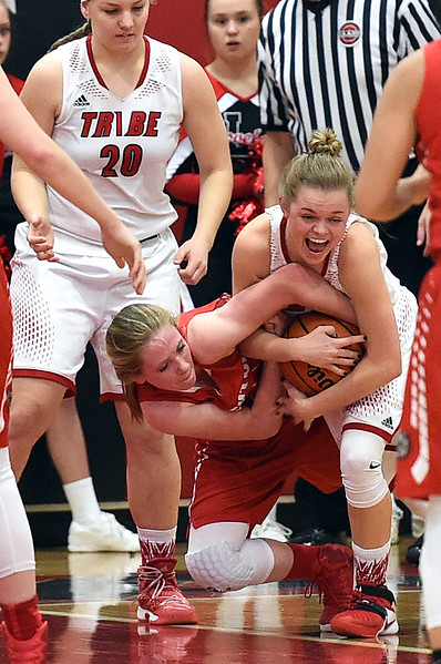 Loveland High's #10 Lexi Eberhardt scuffles for the ball with Brighton's #30 Chloe Doyle during their game Tuesday, Feb. 21, 2017, at Loveland High School in Loveland. (Photo by Jenny Sparks/Loveland Reporter-Herald)