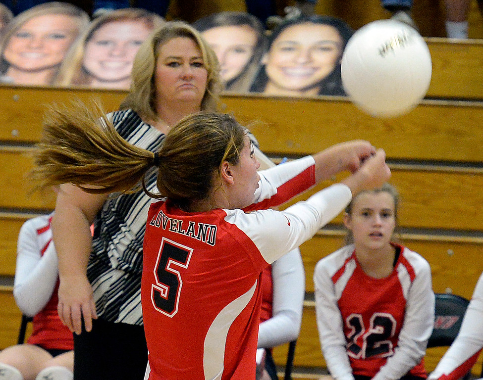 Loveland's #5 Logan Belford hits the ball during their region 11 volleyball game against Cherry Creek Saturday, Nov. 5, 2016, at Loveland High School in Loveland. (Photo by Jenny Sparks/Loveland Reporter-Herald)
