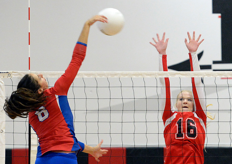 Loveland's #16 Riley Grosboll blocks a shot by Cherry Creek's #8 Maya Borenstein during their region 11 volleyball game Saturday, Nov. 5, 2016, at Loveland High School in Loveland. (Photo by Jenny Sparks/Loveland Reporter-Herald)