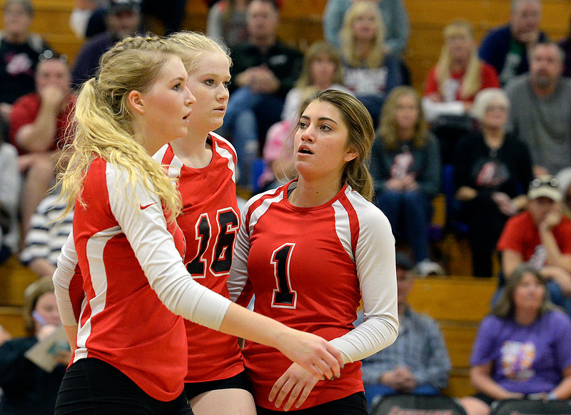 Loveland's #7 Skylar Boyce, left, #16 Riley Grosboll, center, and #1 Raquel Roybal react to losing a point during their region 11 volleyball game against Cherry Creek Saturday, Nov. 5, 2016, at Loveland High School in Loveland. (Photo by Jenny Sparks/Loveland Reporter-Herald)