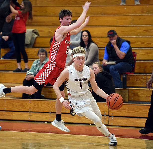 Loveland's Cody Rakowsky takes the ball downcourt past Fairview's Mark Dolan during their game Friday, Jan. 4, 2019, at Loveland High School.   (Photo by Jenny Sparks/Loveland Reporter-Herald)
