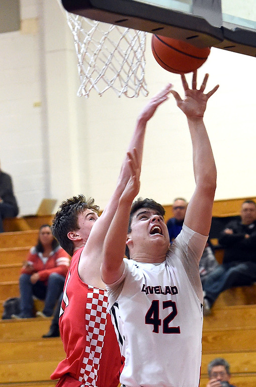 . Loveland\'s Zach Harstad goes up for a shot as Fairview\'s Mark Dolan tries to block during their game Friday, Jan. 4, 2019, at Loveland High School.   (Photo by Jenny Sparks/Loveland Reporter-Herald)