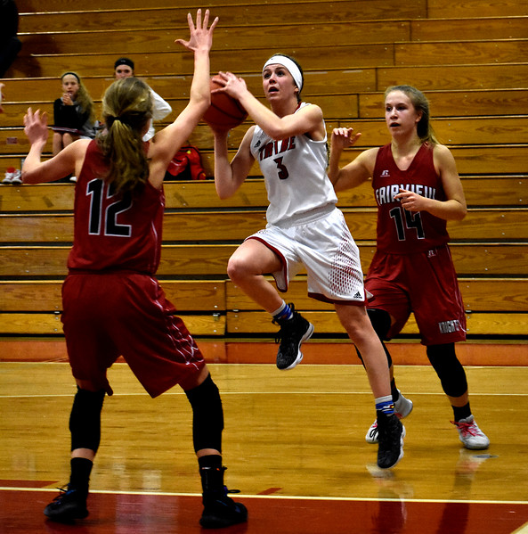 Loveland's (3) Shelby Buhler attempts a shot past Fairview's (12) Denali Pinto during their game on Tuesday, Feb. 13, 2018 at Loveland High School in Loveland. Photo by Thieng Mai/Loveland Reporter-Herald.