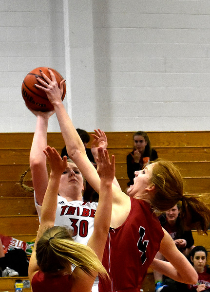 Loveland's (30) Brynne Rydbom attempts to score before Fairview's (4) Lucy Collins blocks her completely during their game on Tuesday, Feb. 13, 2018 at Loveland High School in Loveland. Photo by Thieng Mai/Loveland Reporter-Herald.